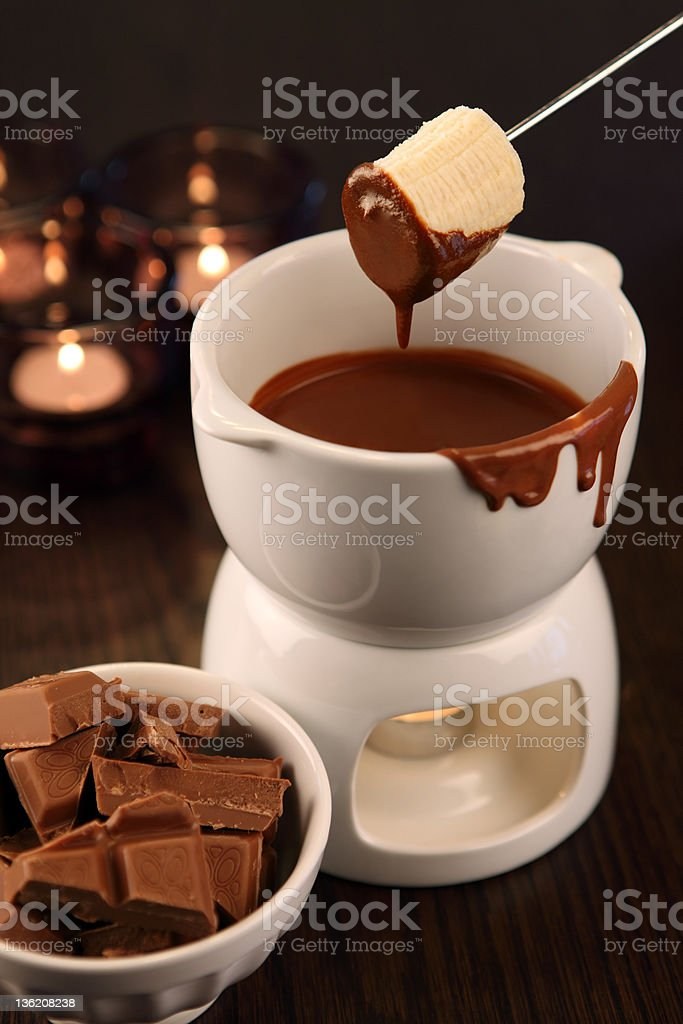 Dipping into chocolate fondue stock photo