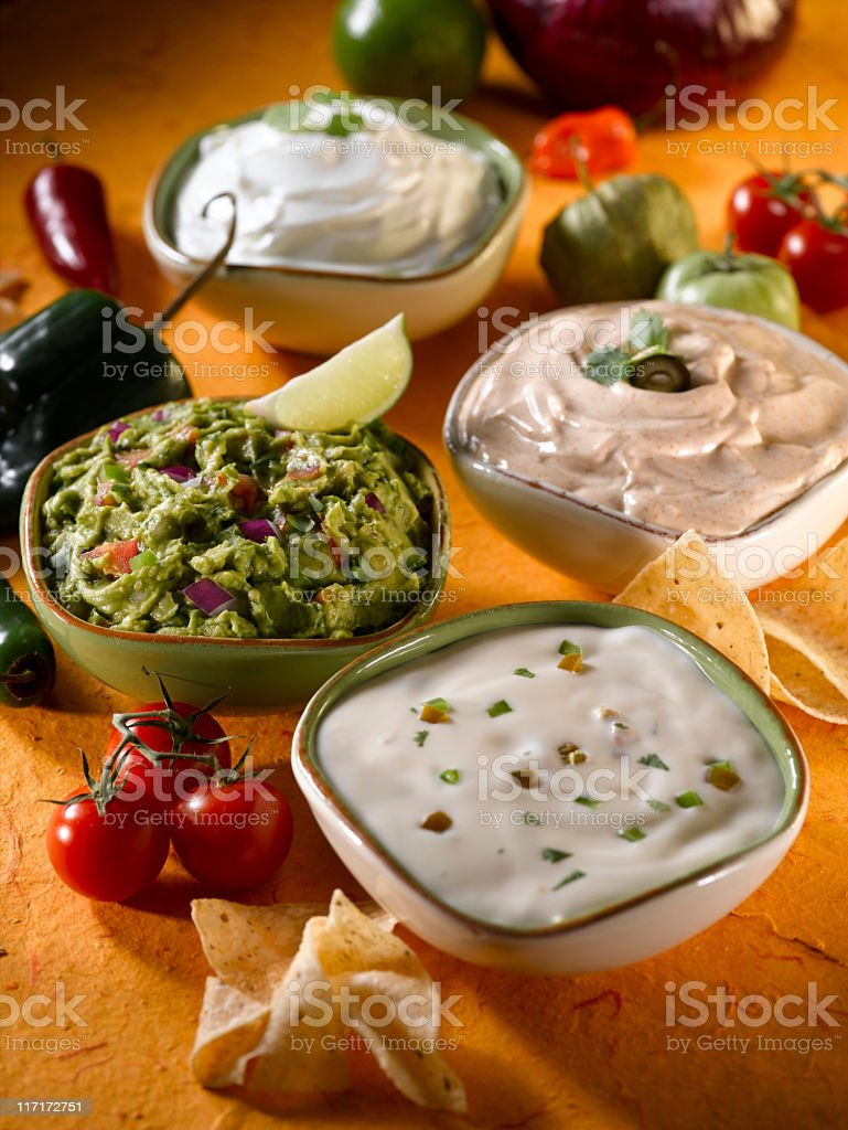 Dips (cheese and guacamole) stock photo