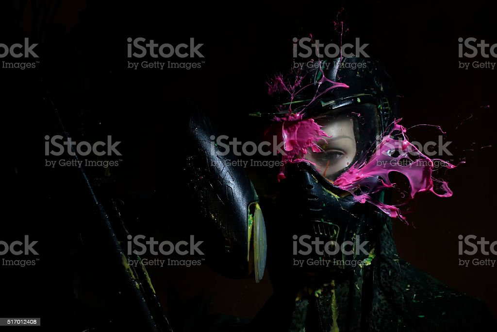 direct hit to  in the paintball game stock photo