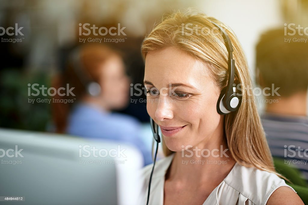 Directing calls with a smile stock photo