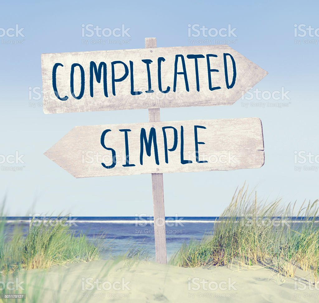 Direction Label on Beach with Complicated and Simple Text stock photo