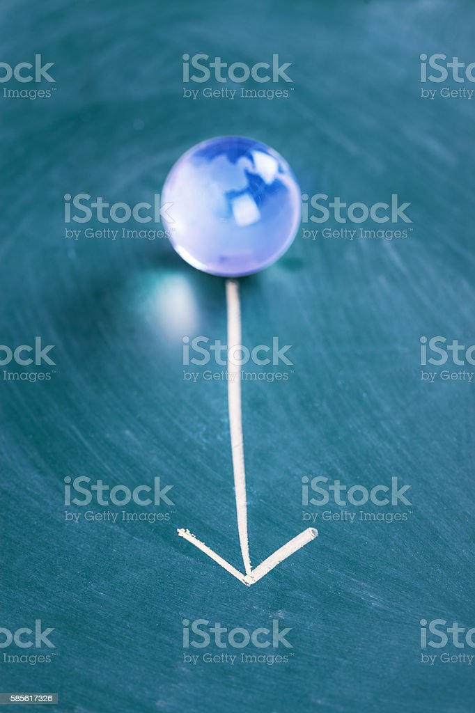 direction on a chalk board with world globe crystal ball stock photo