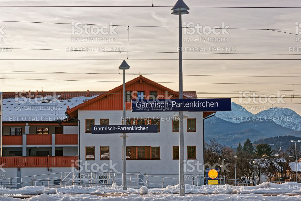 Direction sign at railway train station of Garmisch Partenkirchen stock photo