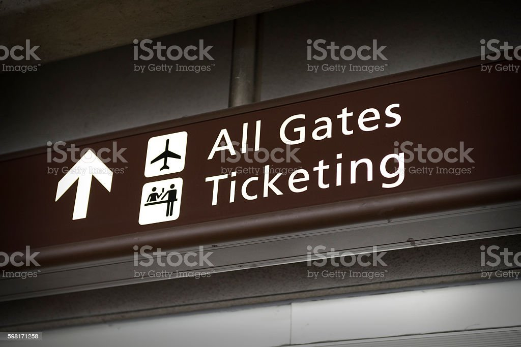 Direction sign to airport ticketing and gates stock photo