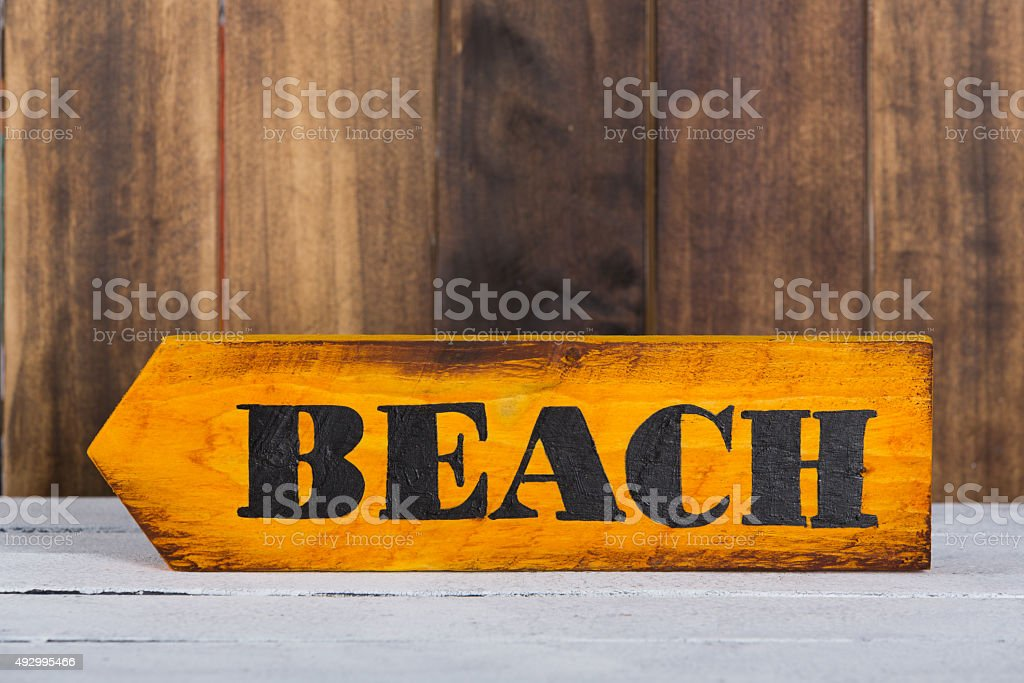 Direction sign with beach stock photo