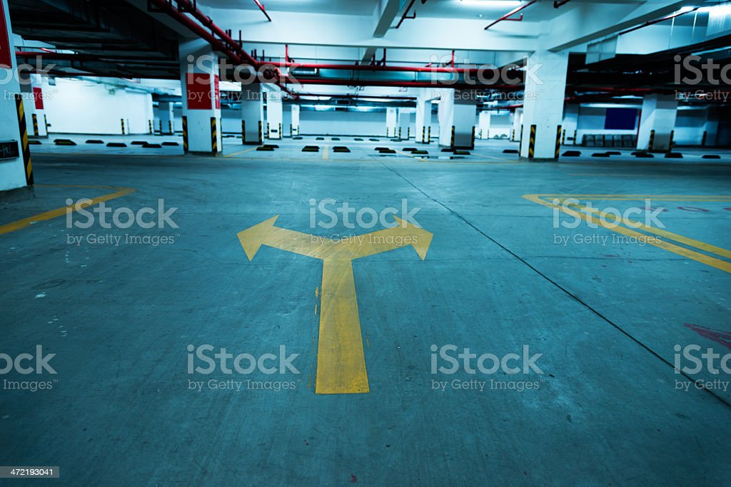 Directional arrow at a empty parking lot stock photo