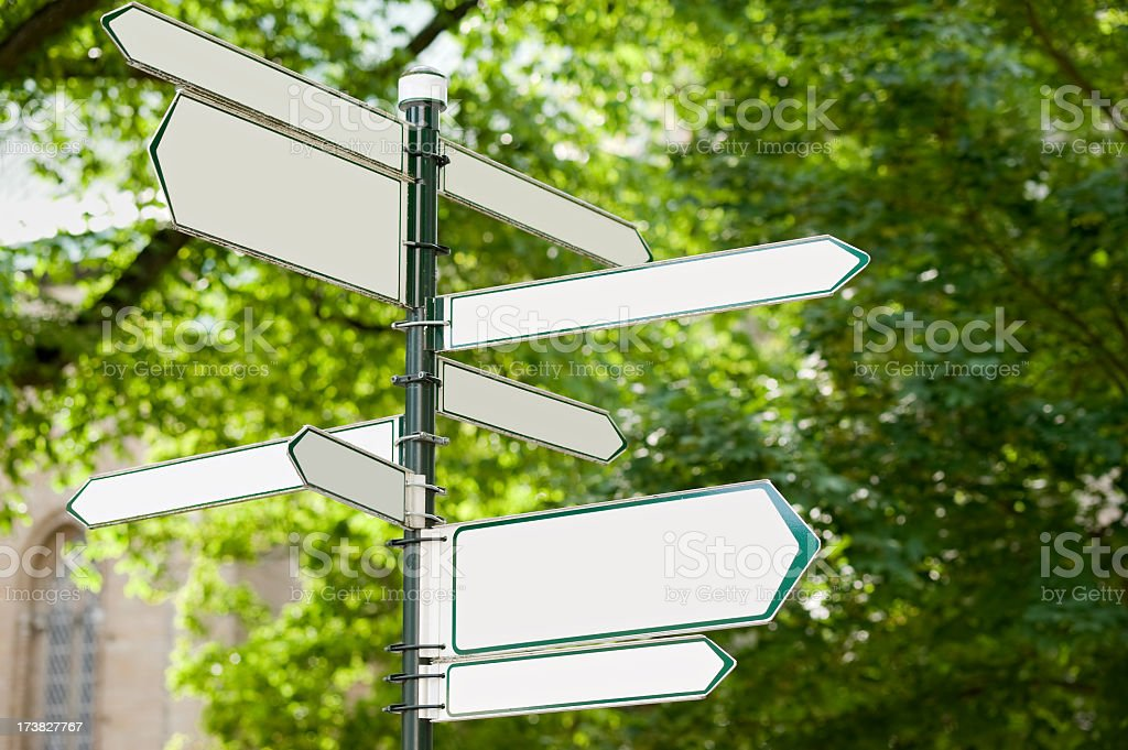 Directional arrow signs on a street corner  royalty-free stock photo