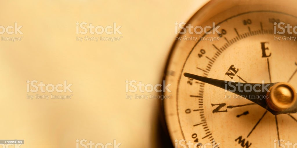 Directional Compass On Warm Golden Background royalty-free stock photo