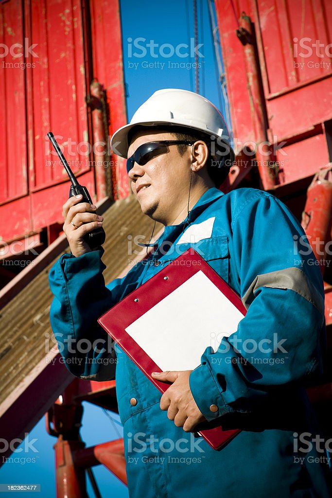 Directional driller at Drilling Rig with Walkie-Talkie royalty-free stock photo