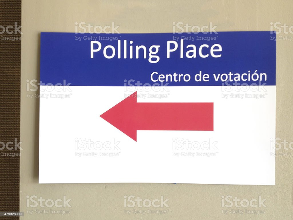 Directional sign at polling place stock photo