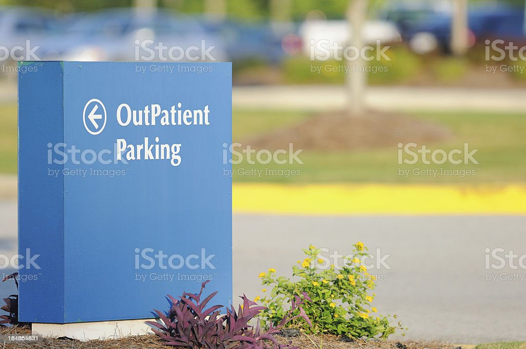Directional sign for outpatient parking stock photo