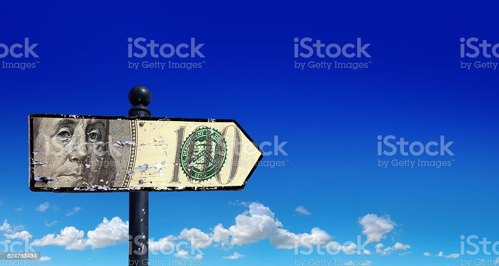 directional sign of money stock photo
