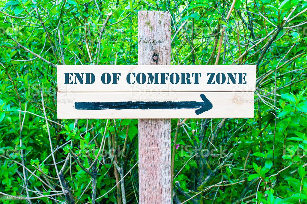 END OF COMFORT ZONE Directional sign stock photo