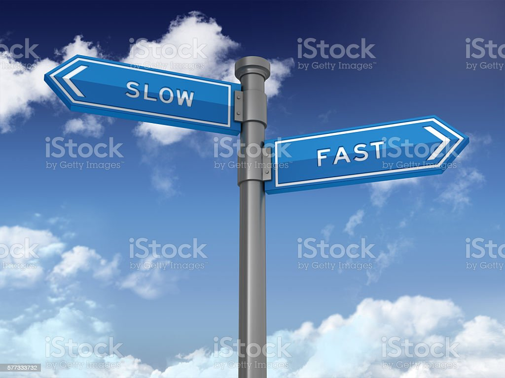 Directional Sign Series:  SLOW FAST stock photo