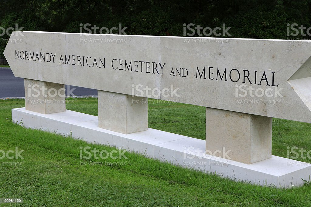 directional sign to the Normandy American Cemetery and Memorial stock photo