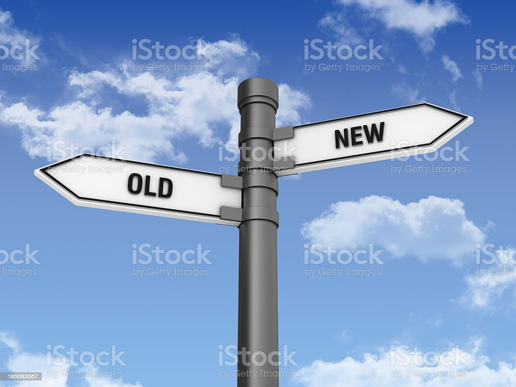 Directional Sign with OLD NEW Words and Sky stock photo