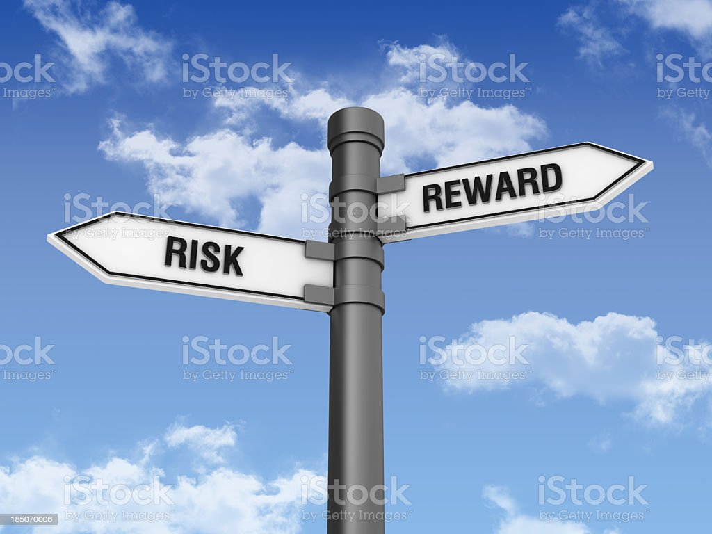 Directional Sign with RISK REWARDS Words and Sky royalty-free stock photo
