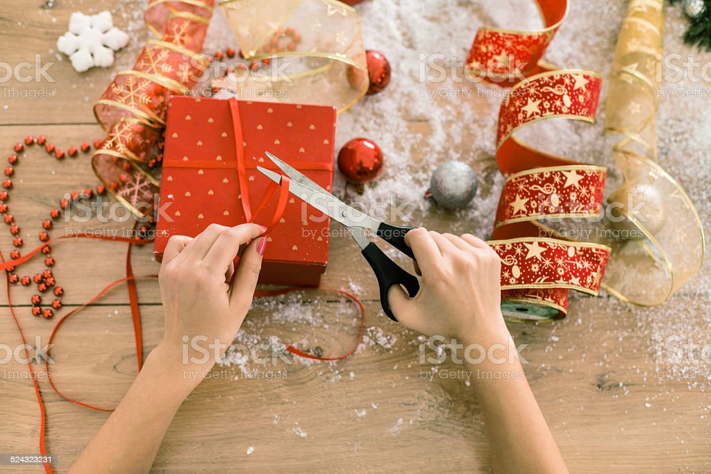 Directly above Of Wrapping Christmas Gift stock photo