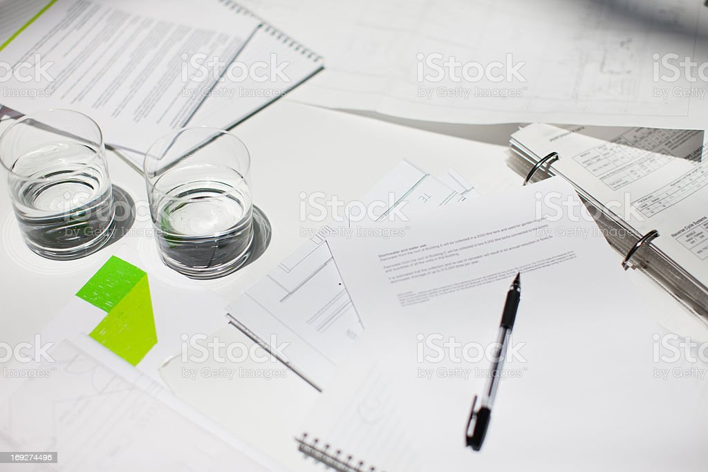 Directly above paperwork, coffee, laptops and notebooks on conference table royalty-free stock photo