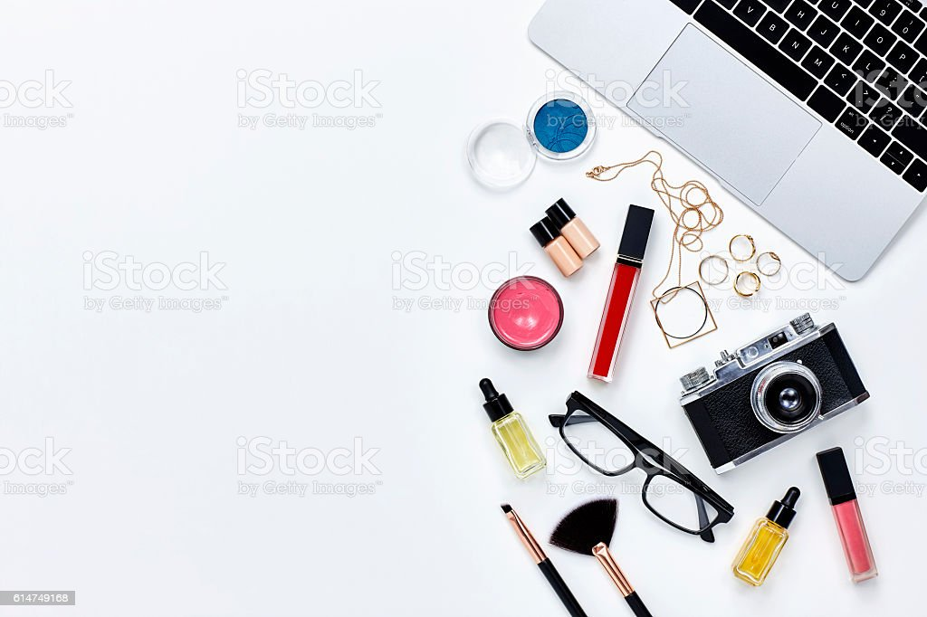 Directly above shot of beauty products with camera and laptop stock photo