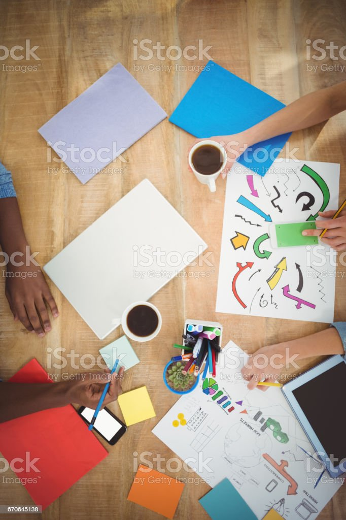 Directly above shot of cropped hands working at desk stock photo