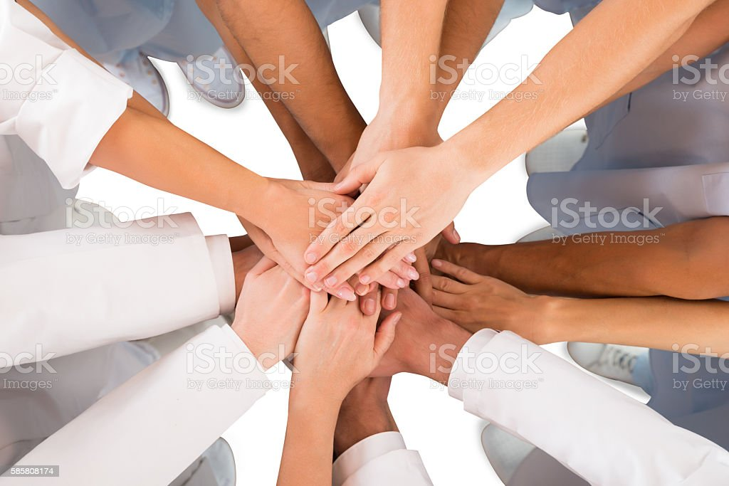 Directly Above Shot Of Medical Team Standing Hands stock photo