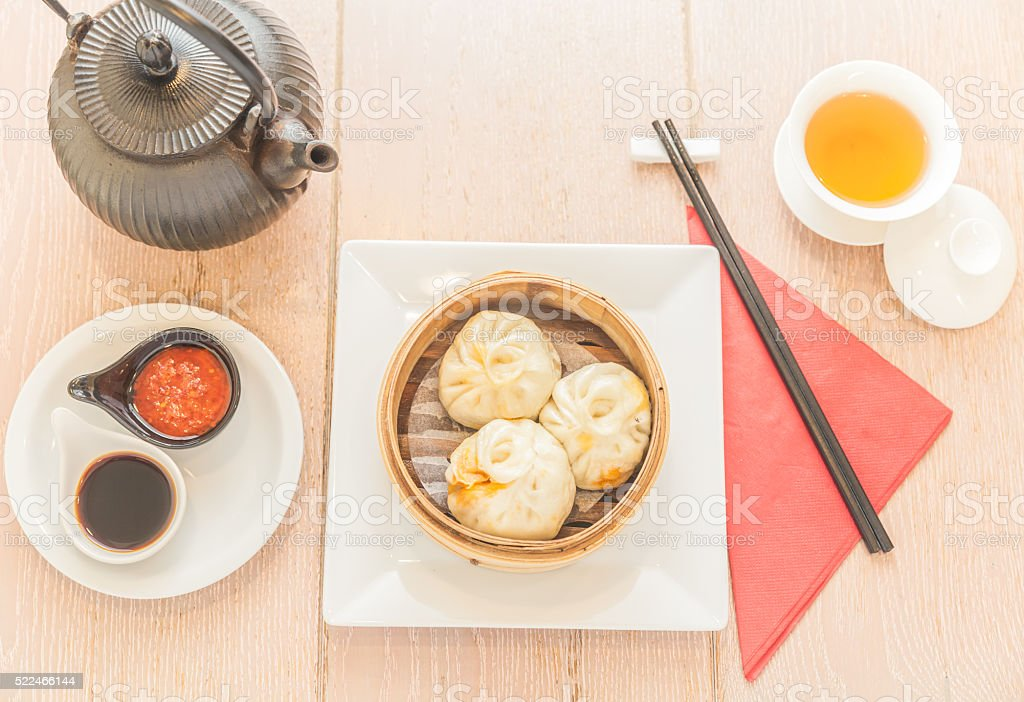 Directly above table view of steaming basket with dim sum stock photo