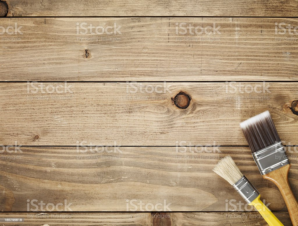 Directly above view of a wooden table and paint brushes stock photo