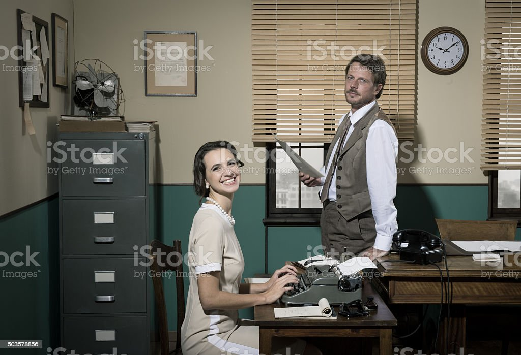 Director and secretary working together in the office stock photo