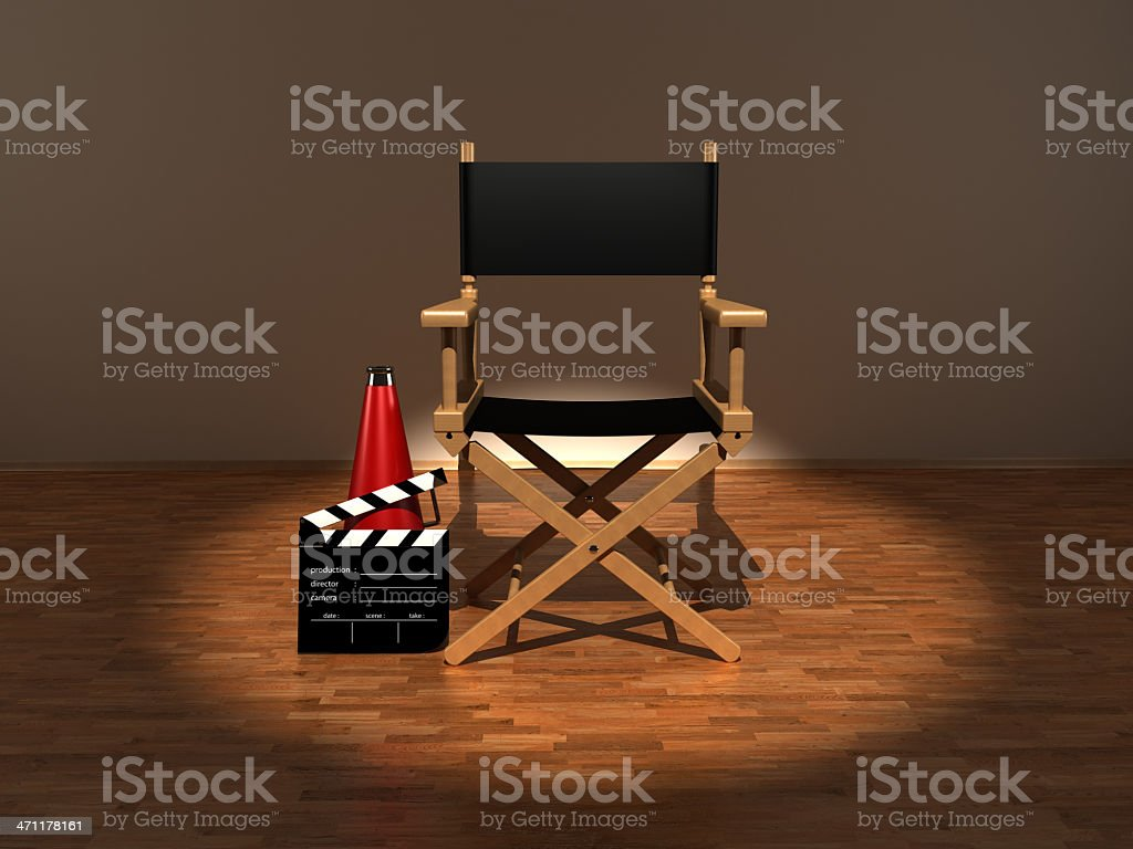 Director chair, megaphone and clapboard under the spotlight stock photo