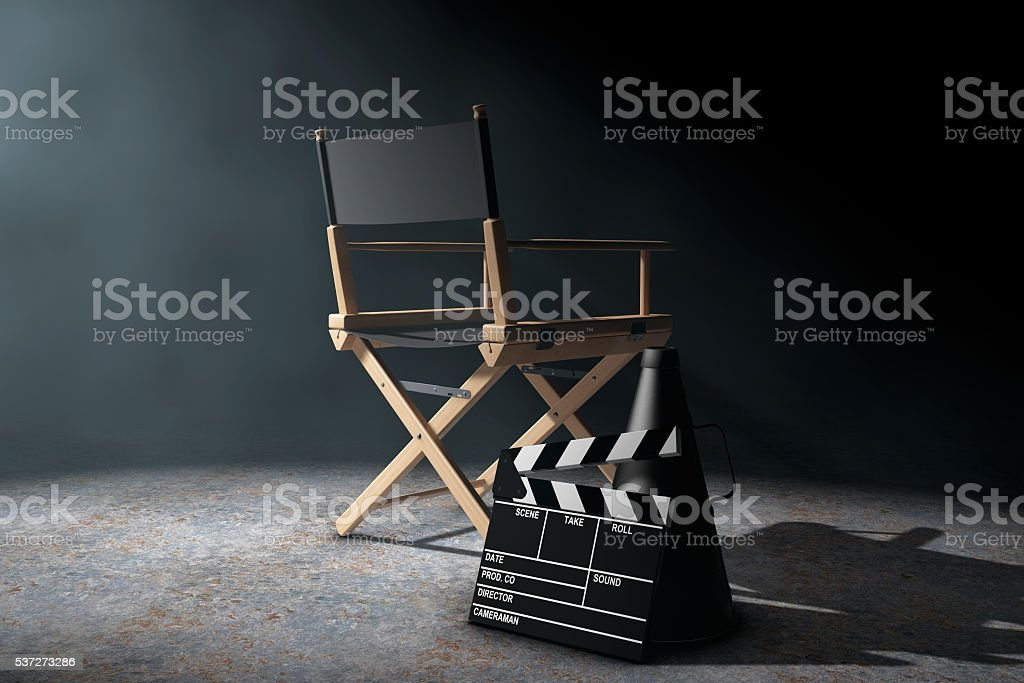 Director Chair, Movie Clapper and Megaphone in the volumetric li stock photo