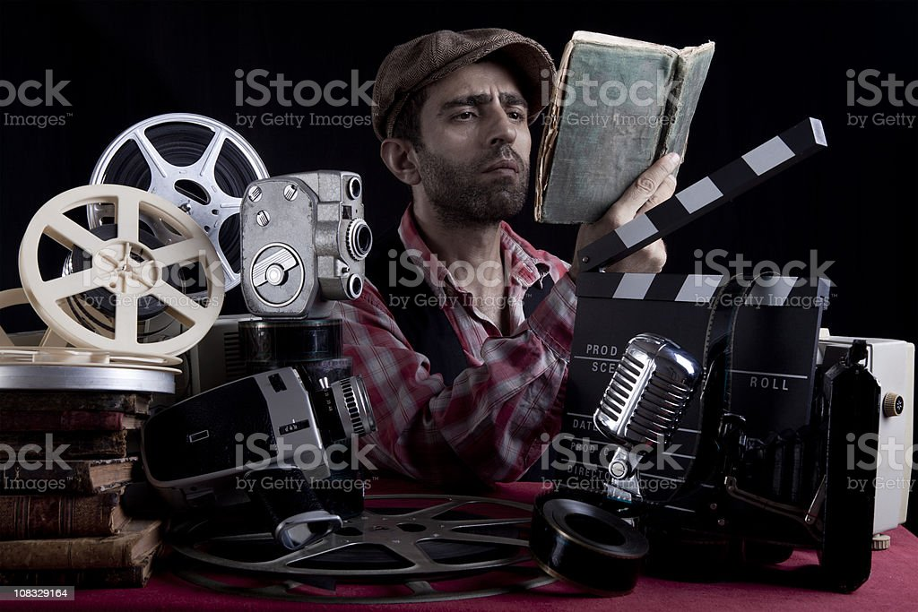 Director In Old Fashioned Costume Reading Script stock photo