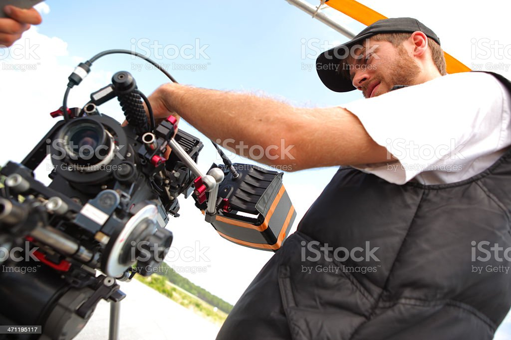 Director of Photography Setting Up Camera stock photo