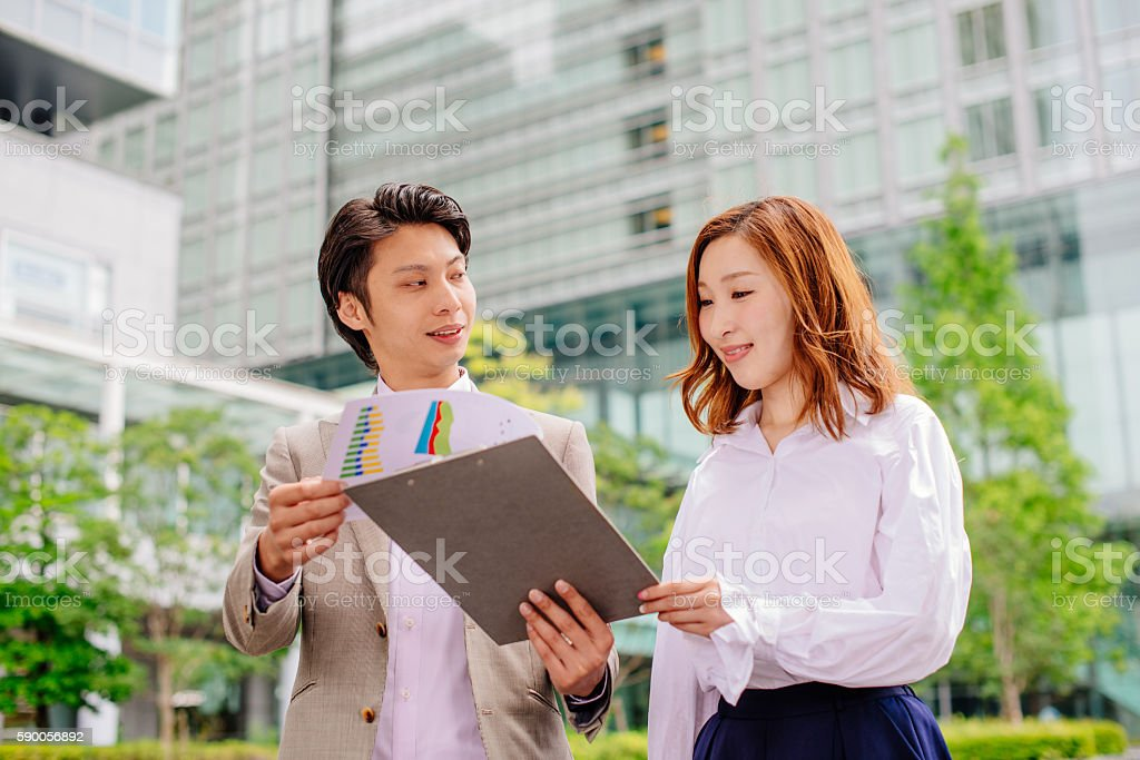 Director showing success chart to his empoyees stock photo