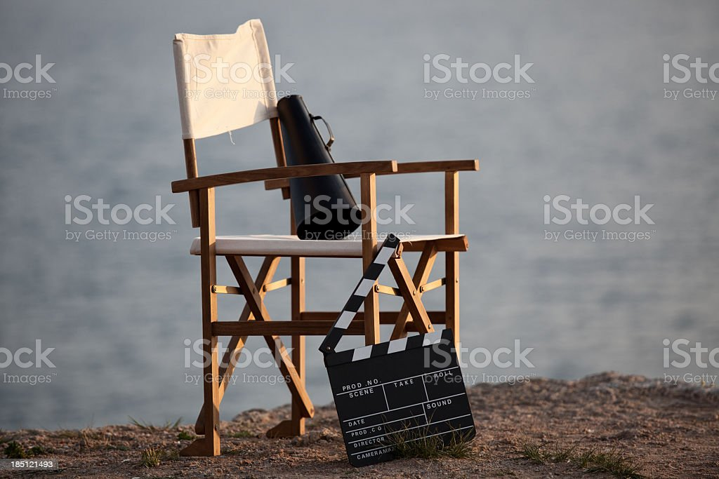 Director's chair in outdoor with megaphone and film slate. stock photo