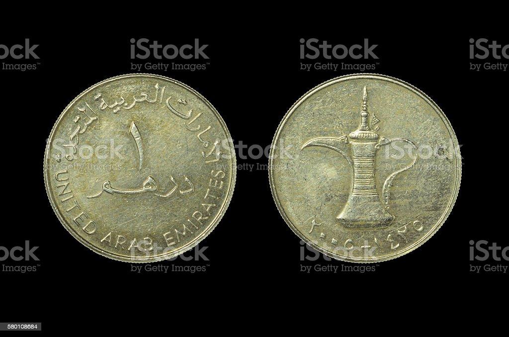 Dirham - Coin UAE isolated on black stock photo