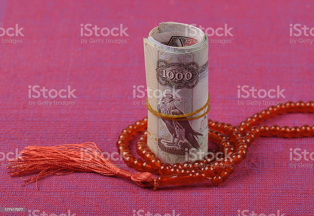 UAE Dirhams and islamic rosary stock photo