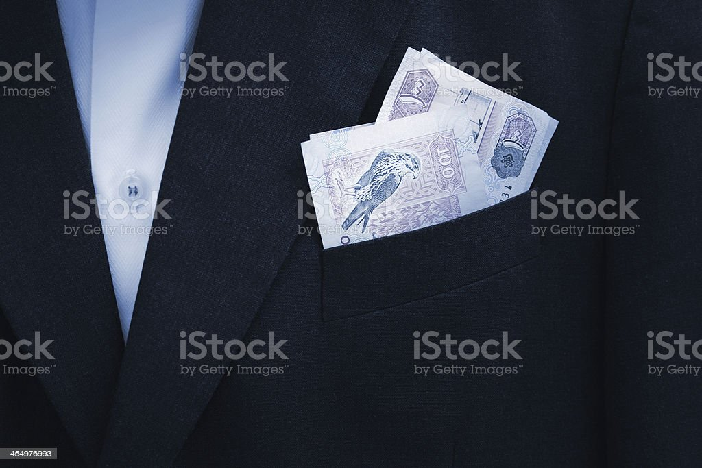 UAE Dirhams banknote in the pocket royalty-free stock photo