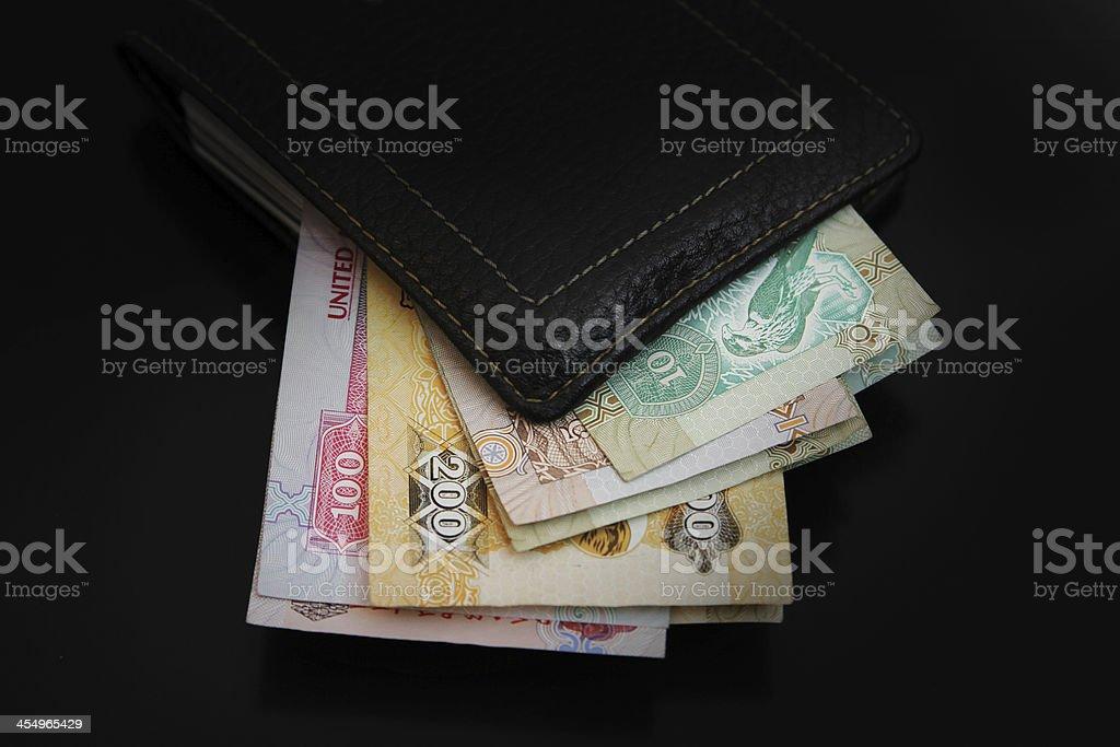UAE Dirhams banknote in the wallet royalty-free stock photo