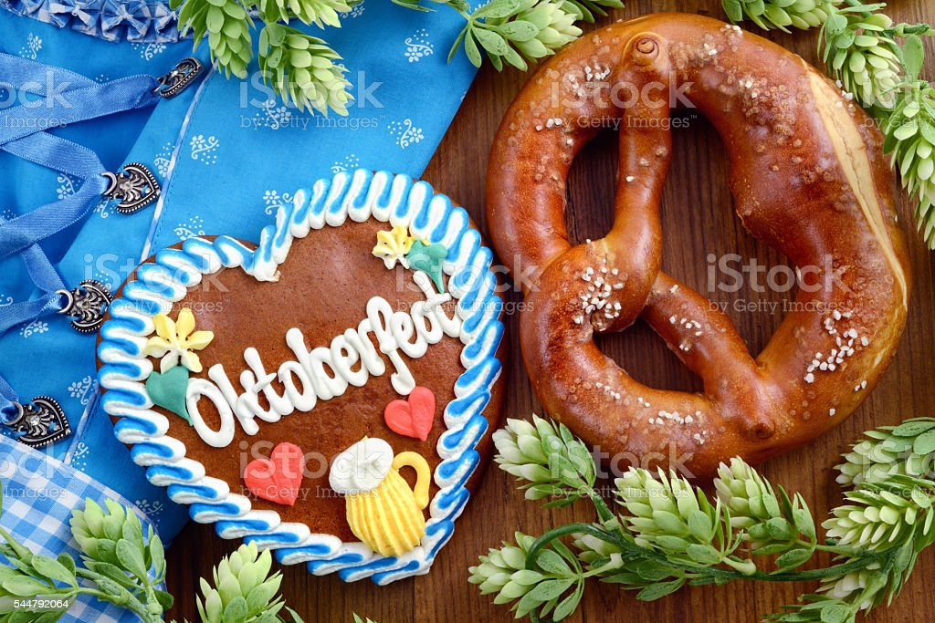 dirndl with gingerbread heart cake and pretzel stock photo