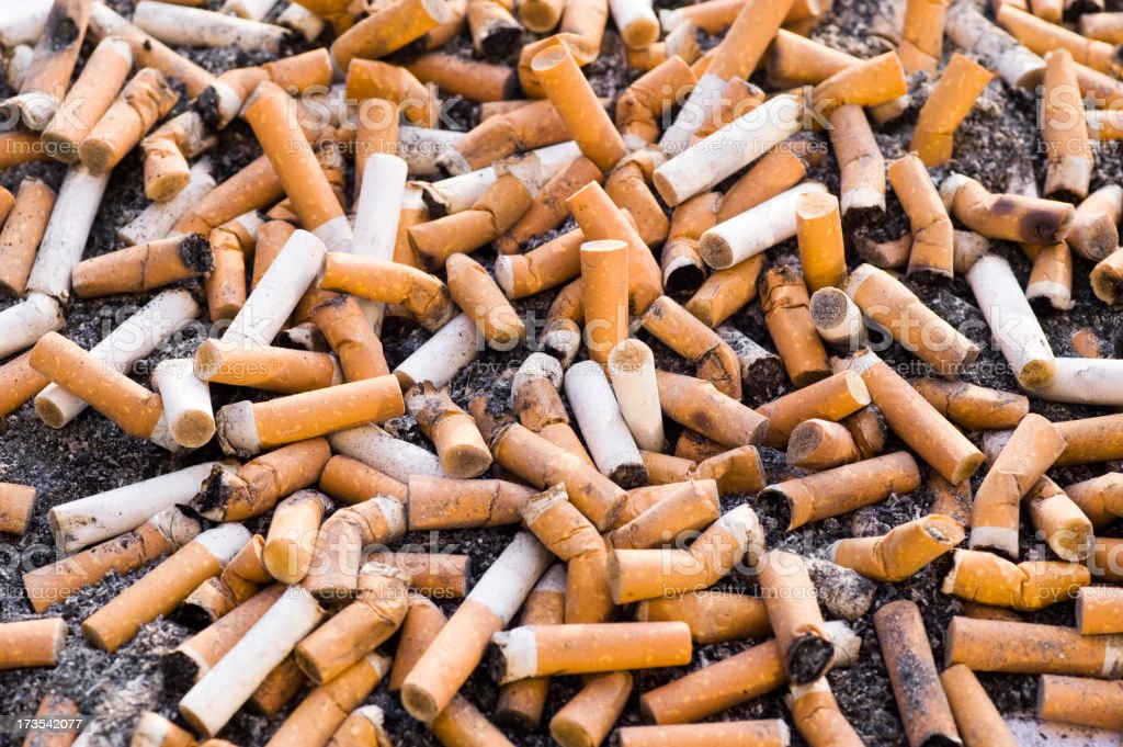 Dirt and cigarettes royalty-free stock photo