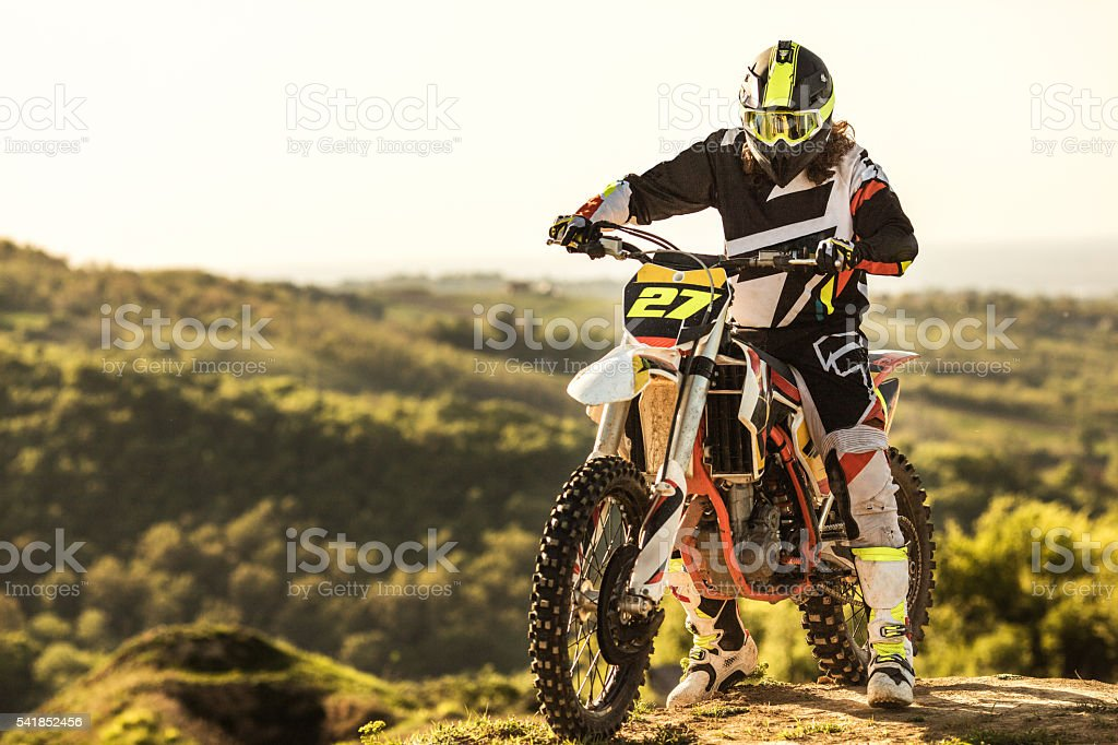 Dirt bike racer on his enduro motorcycle  on extreme terrain. stock photo