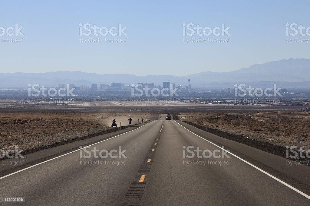 Dirt Biking, Highway And Misty Vegas Skyline royalty-free stock photo
