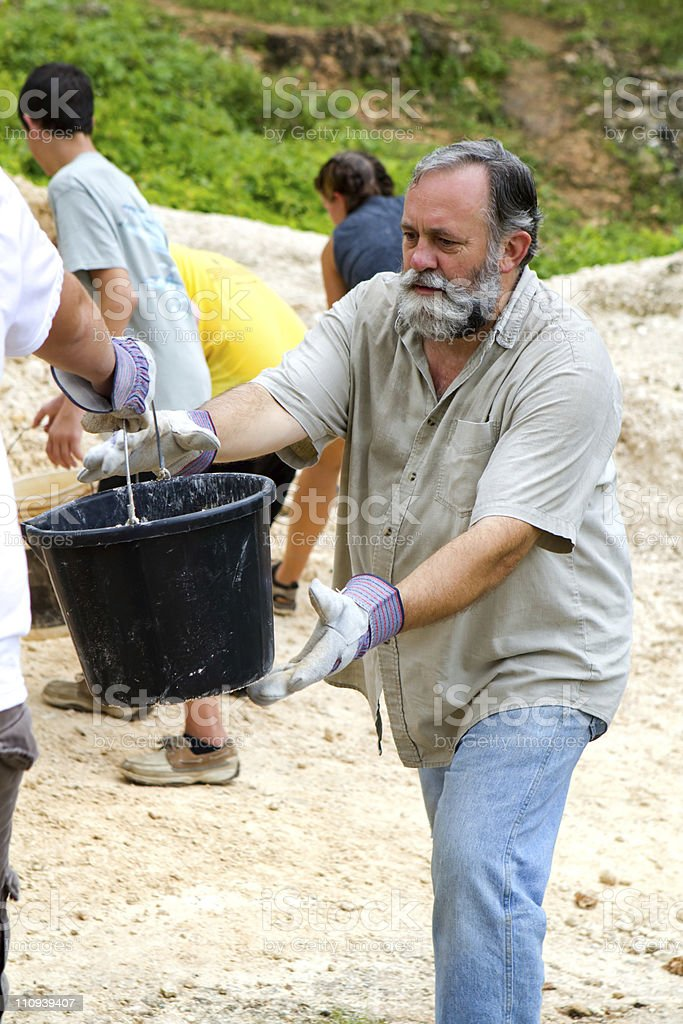 Dirt Bucket Brigade stock photo
