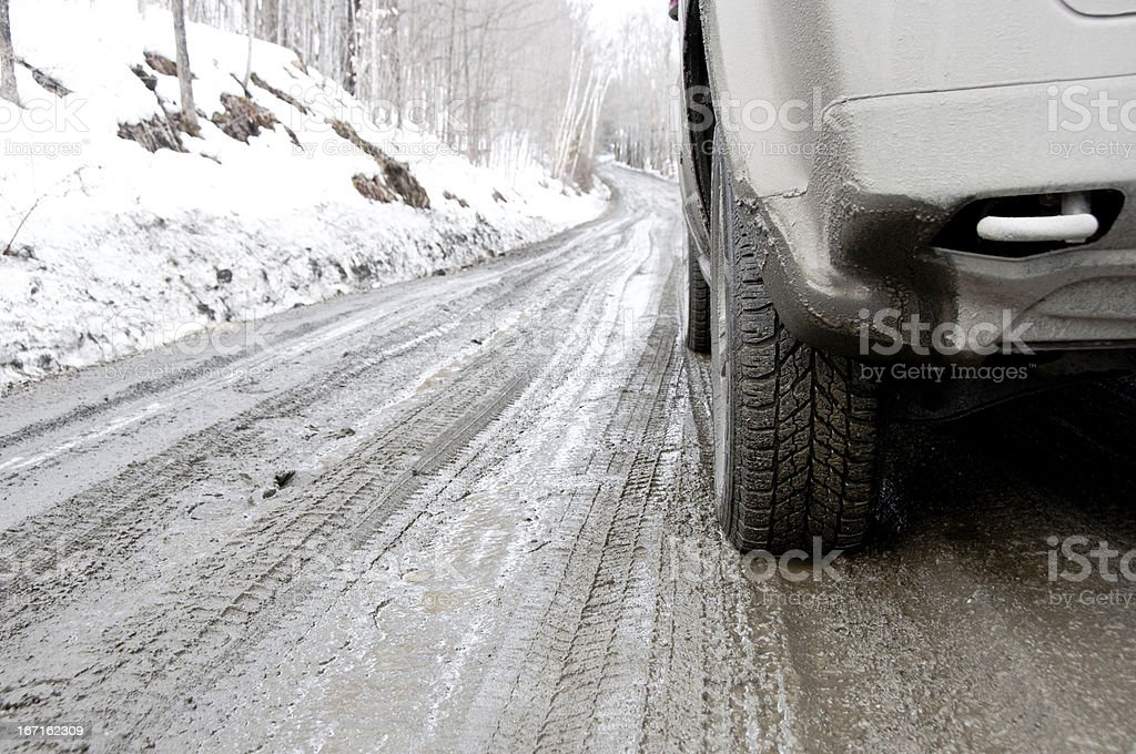 Dirt covered SUV on a muddy road royalty-free stock photo