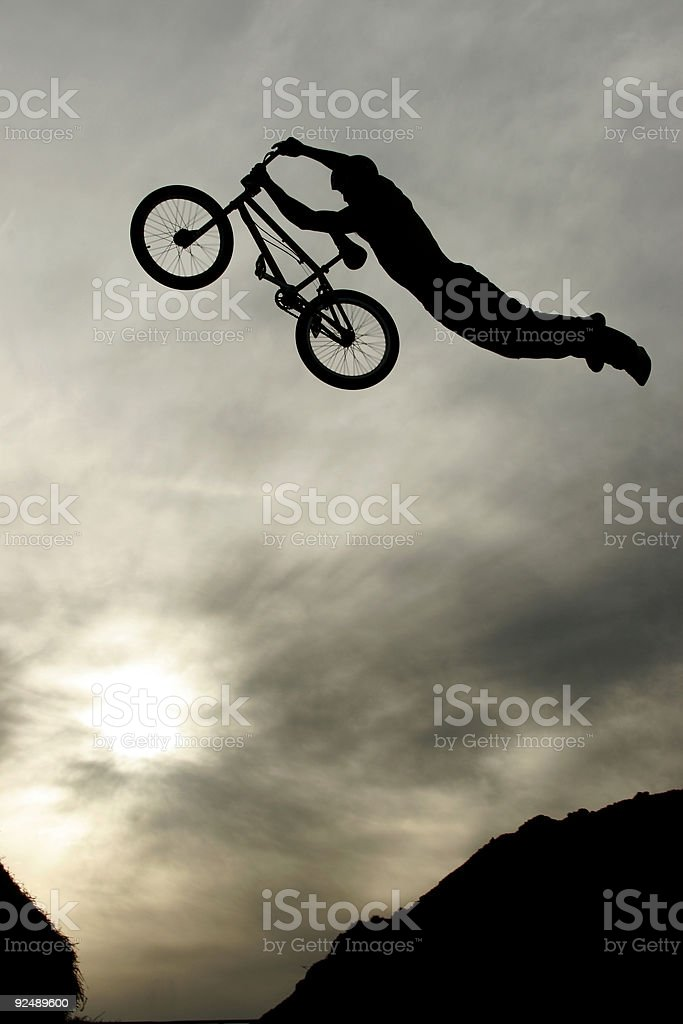 BMX dirt jumper performs a superman trick royalty-free stock photo