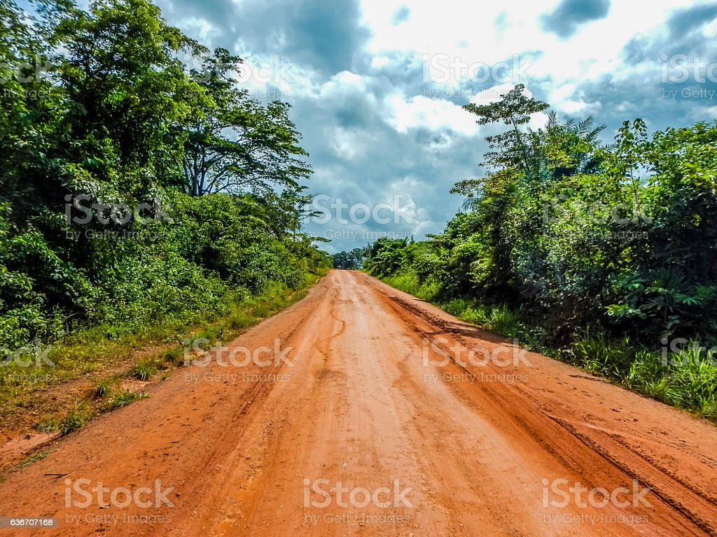 Dirt red road in Liberia. West Africa stock photo