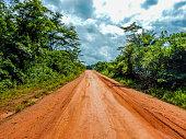 Dirt red road in Liberia. West Africa