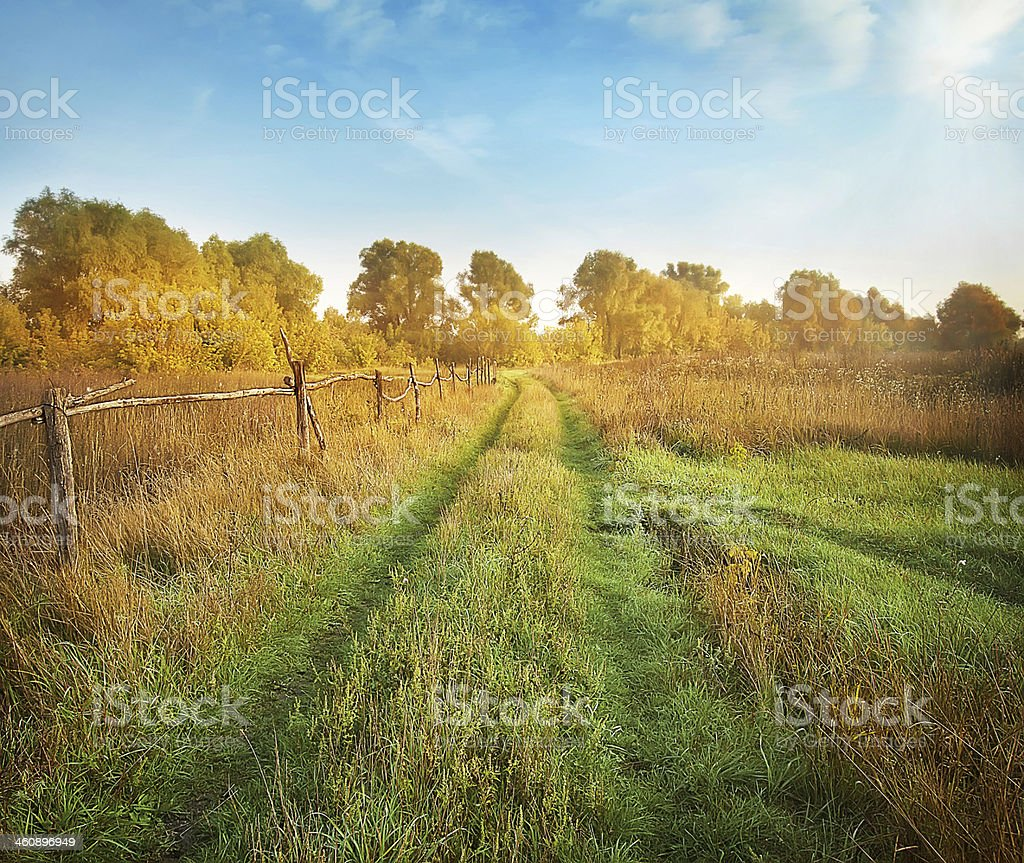 Dirt road and the fence stock photo