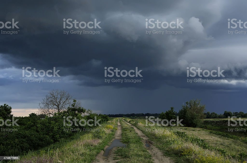 dirt road at the summer dramatic day stock photo